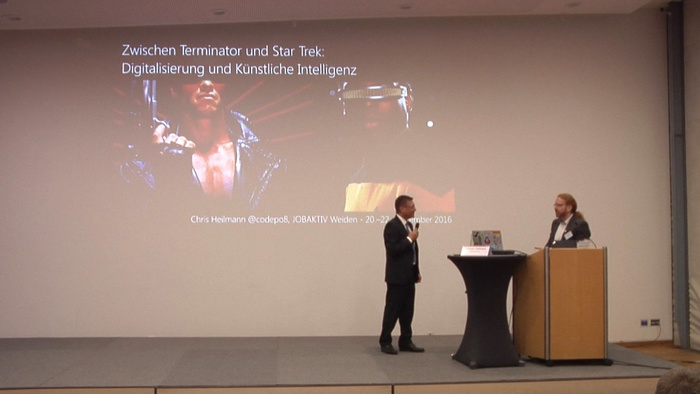 me, giving a keynote on machine learning and work